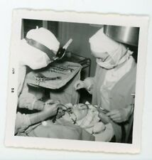 Woman in medical or dental procedure -  vintage snapshot found  Photo