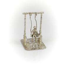 Dutch .934 Silver Miniature Boy Figural on Swing Figurine, c1922