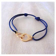 Bracelet menotte doré et cordon bleu nuit