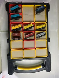 9 x N gauge Wagons in various liveries 8 plank & 1 Conflat INCLUDES Holder!