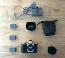 Olympus OM-D E-M5 16MP Mirrorless Digital Camera with Panasonic 25mm f/1.4 Lens