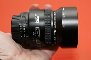 Nikon NIKKOR f/1.8D Auto Focus Lens with filter, hood, and caps
