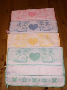 Cross stitch baby bibs and matching towel available.100%cotton, made in Italy