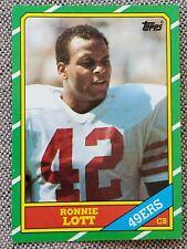 New listing RONNIE LOTT 1986 Topps RC ROOKIE Football Card #168 San Francisco 49ers NFL HOF