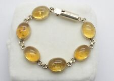 Antiquarian Silver bracelet with amber stones. 20 Century