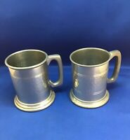 Matched pair of Sheffield half pint English Pewter tankards. good condition.