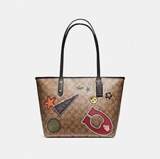 COACH F20910 CITY ZIP TOTE IN SIGNATURE COATED CANVAS WITH VARSITY PATCHES NEW
