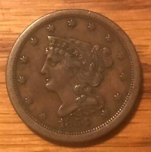 1854 braided hair ,  half cent.  XF