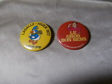 1977 Two Caisse Desjardins Quebec macaroon badge