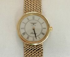 LONGINES 24.497. 580 A LADY'S WATCH-9k 375 GOLD CASE AND STRAP-DIAL COLOUR WHITE