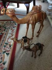 A SET OF 3 VINTAGE PAPER MACHE CAMELS WITH LEATHER REINS /SADDLE /GLASS EYES W/A