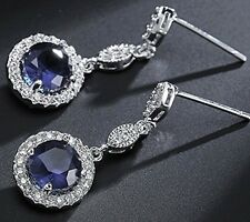 White gold finish blue sapphire and created diamond round cut dangle earrings
