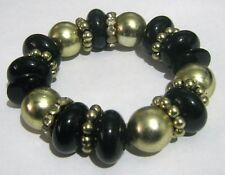 Great Black and gold tone elasticated bracelet with white stone bands