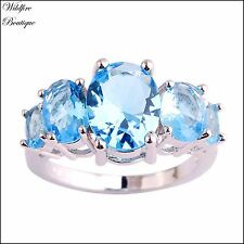 Silver Modern Style Claw Ring with Topaz Blue Oval Cut Crystal Stone Cluster