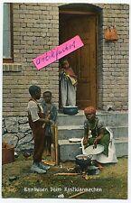 Postkarte um 1910: Deutsch-Südwest-Afrika , Bambusen beim Essen-kochen