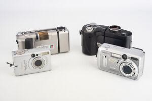 Lot of 4 Digital Cameras Nikon Ricoh Canon Kodak for PARTS OR REPAIR V15