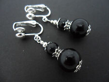A PAIR OF BLACK ONYX BEAD  DANGLY  SILVER  PLATED CLIP ON EARRINGS. NEW.