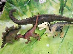 Toy Dinosaur Figures. Brontasaurus Stegosaurus And Raptors.