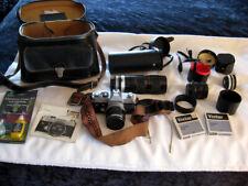 Canon FTb SLR Camera w/ 3 lenses, Carry Case and accessories