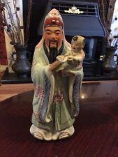 Fabulous Oriental figura di un uomo in possesso di un bambino