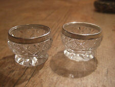 A PAIR OF ANTIQUE (1836) CRYSTAL CUT GLASS SALT BOWLS WITH SOLID SILVER RIMS