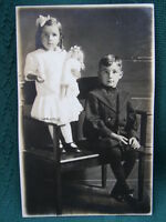 Girl w her doll and her brother- RPPC