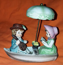 Porcelain Figurine Couple in Boat with Separate Umbrella Collectable