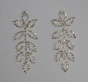 Crystal diamante long drop dangling earrings. Rhinestone bridal leaf design. UK