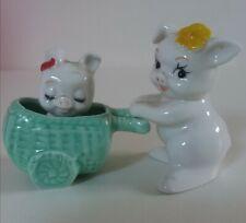 Figurine en porcelaine cochon avec landeau et bébé vintage année 80