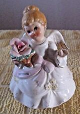 vintage December brithday Angel with music box