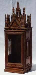 An elaborate tramp art display case with glass front and sides. Great Folk Art.