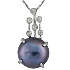 Sterling Silver rhodium plated pendant/chain with 11-12mm Blue mabe pearl and CZ