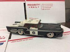 VINTAGE FORD POLICE HIGHWAY PATROL TIN FRICTION CAR