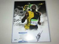 Usain Bolt Jamaica Olympic Gold Signed Autograph 11x14 PHOTO Beckett BAS COA