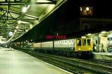 PHOTO  DMU UNIT L588. READING RAILWAY STATION SUNDAY  30.9.84. NIGHT SHOT