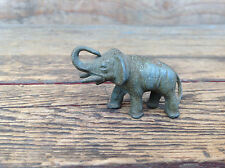 Small Vintage Elephant Figure with Raised Trunk and Tusks