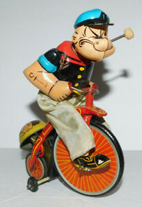 NEAT VINTAGE LINE MAR MARX TIN WIND UP POPEYE ON BICYCLE OR TRICYCLE