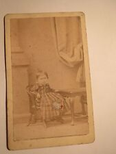 Few rode - in scenery on Chair Seat-Small Child In Dress/CDV