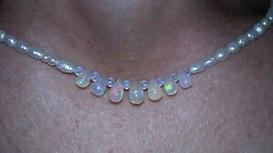 5 carats of pear cut fire opal on white freshwater pearl necklace