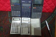 Lot of FIVE(5) CALCULATORS - PARTS - Two(2) TI's, Two(2) Casio's, & One(1) Sharp