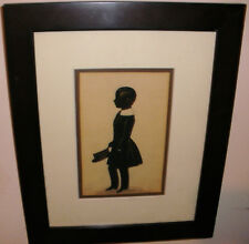 Antique 19th Cut Paper Silhouette of a boy holding cap 1800s English or American