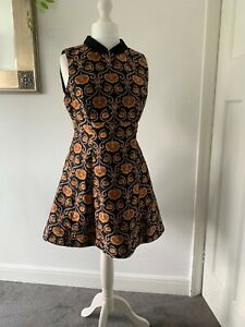 topshop 1960s dress size 14 with typical pattern. Great quality