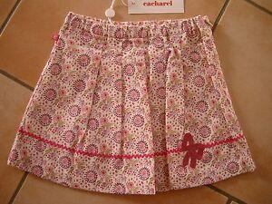 (131) CACHAREL Baby Fein Kord Rock Blumen Muster Stickerei & Logo Fähnchen gr.86