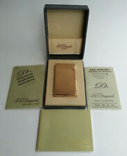 Ancien BRIQUET DUPONT PLAQUE OR modèle strié avec coffret + carnets A RESTAURER