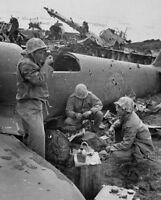 WWII photo American Marines are dining at broken Japanese planes on Iwo Jima 15i