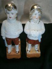 PAIR OF ANTIQUE BOY & GIRL PORCELAIN FIGURINES / ORNAMENTS