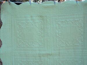 "Sage green quilted throw  53x61"" scalloped edges"