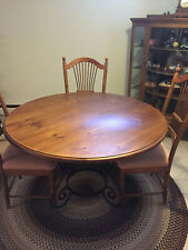 round table and chair set with corner rack