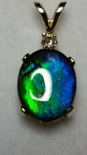 FLASHY NATURAL 1.95 TCW 10X8 MM OVAL AMMOLITE AND DIAMOND PENDANT IN 10KT GOLD