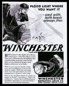 1930 Boy Scout making fire Winchester headlight hear-mounted flashlight print ad
